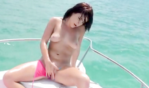 Horny babe in sexy pink bikini masturbates her pussy in a yacht