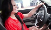 Delicious brunette shows her goods in the street for POV porn