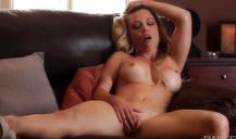 Glamour blonde with big boobies spreading legs and masturbating