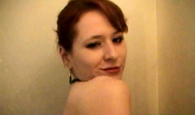 Smiling redhead wife is taking a hot shower on the camera