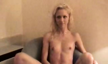 Skinny young blonde spreads her legs and masturbates on the camera