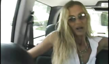 Horny as hell blonde is fingering her cute pussy on the backseat